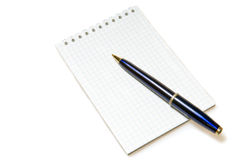 Spiral notepad with pen Stock Image