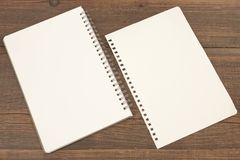 Spiral Notepad And Torn White Blank Page On Wood Background Royalty Free Stock Photography
