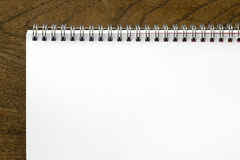 Spiral notepad on wooden desk Royalty Free Stock Image