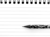 Spiral notepaper and pencil. Black and white illustration of lined, spiral notepaper and decorative pencil Stock Photo