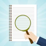 Spiral opened notepad with loupe. Top view. Vector illustration Royalty Free Stock Images