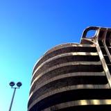 Spiral parking garage ramp. Looking up at spiral concrete parking garage ramp with clear blue sky stock photos