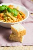 Spiral pasta with basil Royalty Free Stock Photos