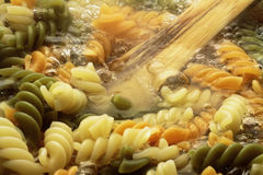 Spiral pasta in boiling hot water Stock Photo