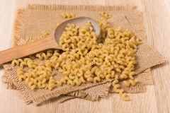 Spiral pasta on a burlap sack Royalty Free Stock Photography