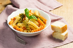 Spiral pasta with cheese on plate Stock Photos