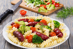 Spiral Pasta salad with  broccoli and grilled sausages Stock Image