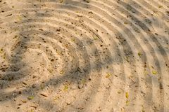 Spiral pattern design in sand on beach. Spiral pattern design in sand on the beach stock photo