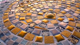Spiral pattern golden mosaic floor Royalty Free Stock Photography