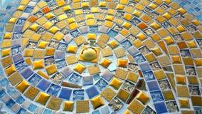 Spiral pattern golden mosaic floor Stock Images