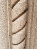 Spiral pattern stone column stock images