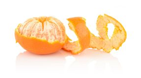Spiral peel of mandarin  on white Stock Photos