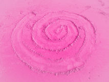 Spiral in pink sand Royalty Free Stock Photography