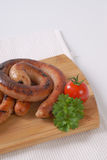Spiral pork sausages Stock Photography