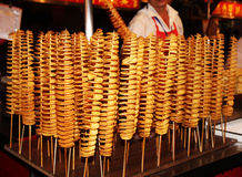 Spiral potato, fried. China. Potatoes deep-fried and sliced spiral Stock Photo