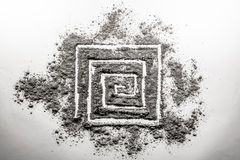 Spiral rectangular shape drawing made in ash. On a white background Royalty Free Stock Photos