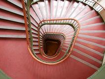 Spiral red staircase viewed from above. With diminishing perspective Stock Image