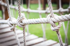 Spiral rope bridge for children to play. Royalty Free Stock Images