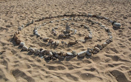 Spiral on the sand. Stony spiral on the sand in Greece Royalty Free Stock Images