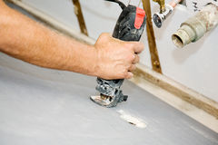 Spiral Saw Cuts Drywall royalty free stock images
