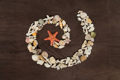 Spiral of seashells and red star Stock Photography