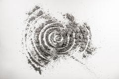Spiral shape helix drawing in spattered ash Royalty Free Stock Photography