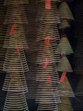 Spiral shape incense from tourist visitors in macau. Long cone spiral shape incense from tourist visitors burning together inside a famous buddhism temple in Royalty Free Stock Photography