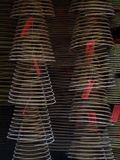 Spiral shape incense from tourist visitors in macau. Long cone spiral shape incense from tourist visitors burning together inside a famous buddhism temple in Royalty Free Stock Images