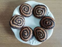 Brown espiral. Spiral shaped cookies in brown tones stock photos