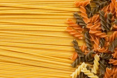 Spiral shaped pasta and spaghetti Stock Photography