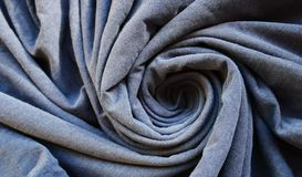 Spiral shapes clothes textile surface. Spiral shapes clothes textile background royalty free stock photography
