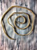 Spiral shoe lace. Close view of show lace in spiral form Royalty Free Stock Photos