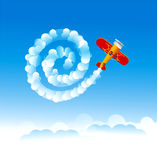 Spiral of smoke in the sky. Vintage plane doing a smoke spiral in the sky Royalty Free Stock Images