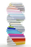Spiral stack of rainbow colored books Stock Photos