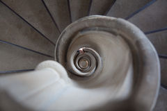 Spiral stair with hand Stock Photo