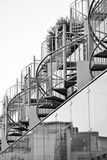 Spiral stair beside spiral stair above glass front Royalty Free Stock Photo