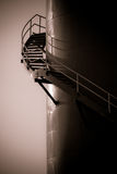 Spiral staircase. Monochrome image of a staircase on the side of a stack at a steam generation plant at dawn royalty free stock photography