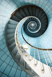 Spiral staircase. A spiral staircase going up with blue tiled wall (Charente Maritime / France stock photo