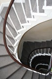 Spiral staircase. A beautiful wooden spiral staircase royalty free stock image