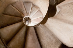 Spiral Staircase. Tight spiral staircase descending, sunlit Stock Photography