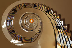 Spiral Staircase. Seven story spiral staircase from below royalty free stock photography