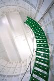 Spiral staircase. Green metal spiral staircase inside a white walled lighthouse royalty free stock photography