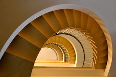 Spiral staircase. In a building with beautiful, warm lighting stock photo