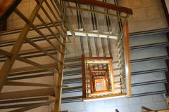 Spiral staircase. Taken from the lower floor looking up through the stairwell royalty free stock images