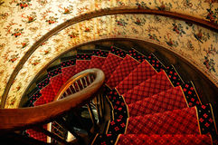 Spiral staircase. With red carpet royalty free stock images