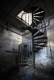 Spiral staircase in an abandoned factory building. Iron spiral staircase in an abandoned factory building royalty free stock photography