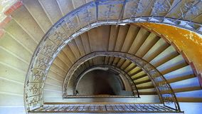 Spiral staircase from above in a very old apartment building in Hungary, Europe. Spiral staircase from above in a very old apartment building with iron royalty free stock images