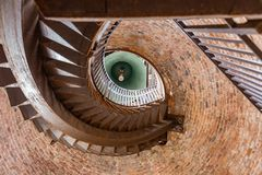 Spiral staircase and bell on the famous tower Lamberti on Verona, Italy royalty free stock photo