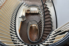 Spiral staircase with black railing Stock Photos