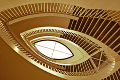 Spiral staircase. Bottom view. Architectural construction in the form of a spiral staircase brown color Stock Photography